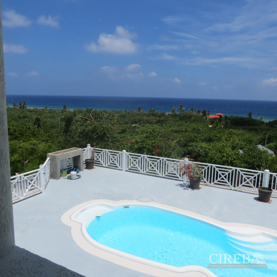 CAYMAN BRAC GUEST HOUSE WITH BEACH LOT! - Image 1
