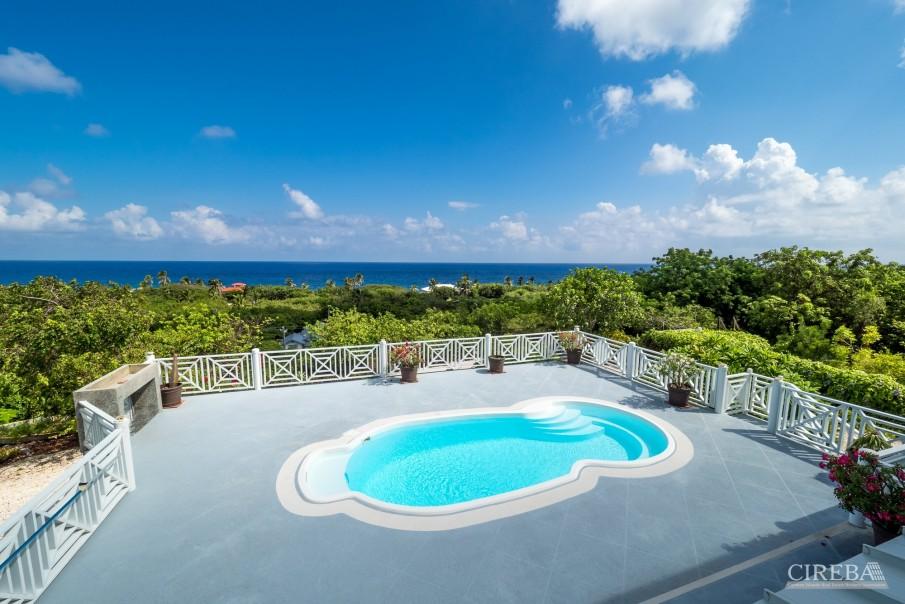 CAYMAN BRAC GUEST HOUSE PLUS BEACH FRONT LOT - Image 4